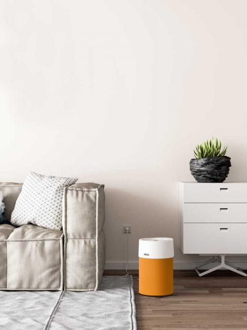 Ideal Luftreiniger AP40 Pro Wohnzimmer mit Textilbezug orange